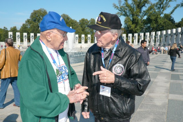 Maurice Sperandieu (right) and Morris Fodiman share war experiences in Belgium at the National World War II Memorial in Washington, D.C., Oct 23. Fodiman served in the 76th Infantry Division during the war.