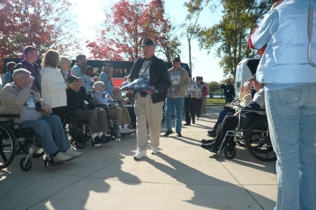 World War II veterans salute during a ceremony at the National World War II Memorial Oct. 23 in Washington, D.C. The event was made possible for the veterans through 2009 proceeds from the Bastogne Historical March.""