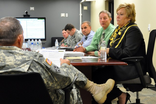 Ted Kientz, U.S. Army Forces Command liaison officer, informs General James D. Thurman, commanding general, FORSCOM, that construction of the new FORSCOM/U.S. Army Reserve Command headquarters complex at Fort Bragg, N.C, is on schedule, Oct. 28, 2010. The 2005 Base Realignment and Closure Legislation directed the closure of Fort McPherson, Ga., and relocation of each command's headquarters to Fort Bragg, by Sept. 15, 2011.