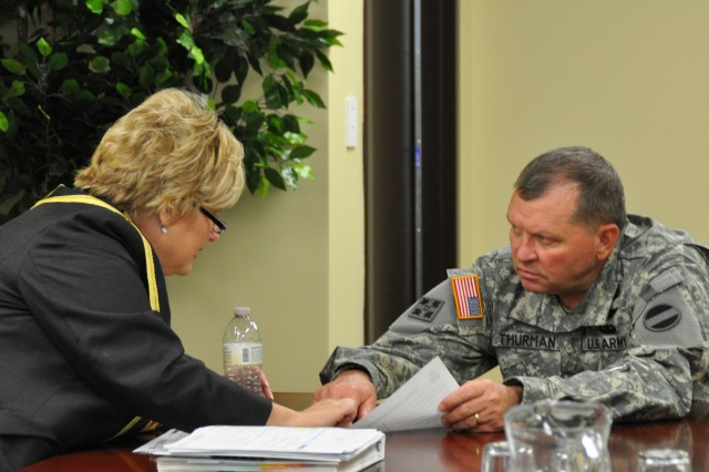 General James D. Thurman, commanding general, U.S. Army Forces Command listens as Ronna Rowe Garrett, officer in charge, FORSCOM (Forward), discusses key points about preparations for the 2005 Base Realignment and Closure Legislation directed relocation of Headquarters, FORSCOM to Fort Bragg by Sept. 15, 2011.  Garrett leads the team responsible for setting the conditions for a successful arrival of the command's main body beginning in March, 2011.