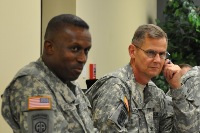 Major General Rodney O. Anderson (left), deputy commanding general, XVIII Airborne Corps and Fort Bragg, and Col. Mason W. Thornal, Task Force Bragg chief of staff, discuss relocation issues with General James D. Thurman, commanding general, U.S. Army Forces Command, during an Oct. 28, 2010, briefing at the FORSCOM (Forward) command post at Fort Bragg, N.C. The 2005 Base Realignment and Closure Legislation directed the closure of the Fort McPherson, Ga., and relocation of Headquarters, FORSCOM to Fort Bragg by Sept. 15, 2011.