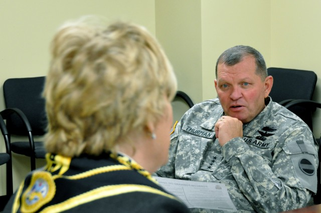 General James D. Thurman, commanding general, U.S. Army Forces Command, listens as Ronna Rowe Garrett, officer in charge, FORSCOM (Forward), updates him about preparations at the command\'s forward command post,Oct. 28, 2010, at Fort Bragg, N.C. The 2005 Base Realignment and Closure Legislation directed the closure of the Fort McPherson, Ga., and relocation of Headquarters, FORSCOM to Fort Bragg by Sept. 15, 2011.