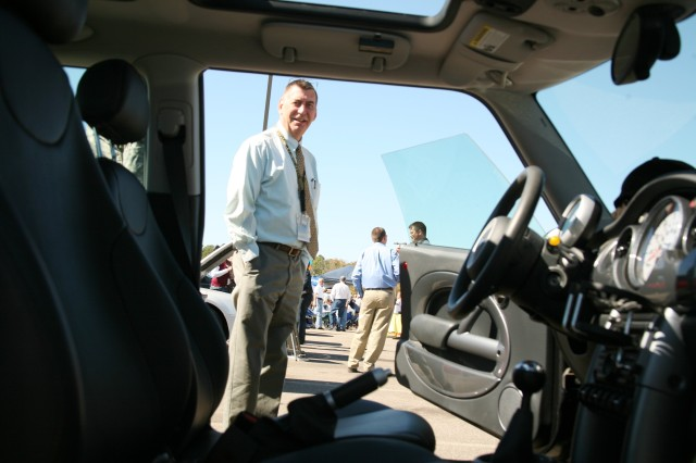 John Crown, deputy chief of staff, G3, looks at one of the cars on display during the U.S. Army Space and Missile Defense Command/Army Forces Strategic Command Tailgate Party and Car Show Oct. 21.