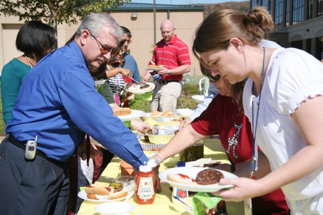 U.S. Army Space and Missile Defense Command/Army Forces Strategic Command employees dress their burgers and dogs during the command's Tailgate Party and Car Show Oct. 21.