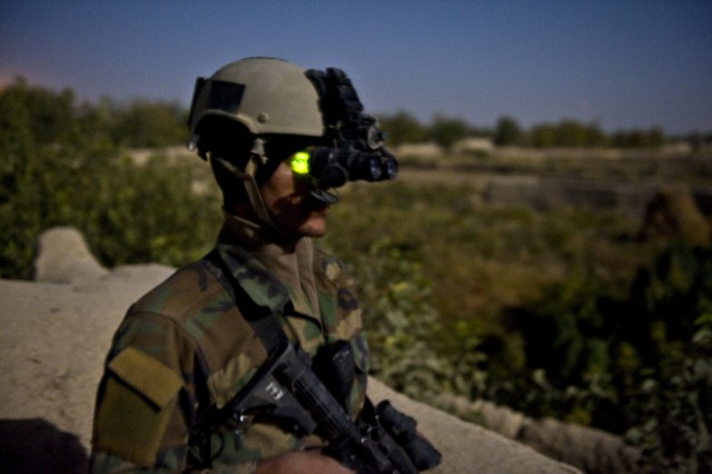 An Afghan Soldier with 3rd Commando Kandak utilizes night-vision goggles to illuminate the darkness during his nighttime guard shift, Oct. 25, 2010, in Panjwa'i District, Kandahar Province, Afghanistan. (U.S. Army photo by Spc. Daniel P. Shook/Special Operations Task Force - South).