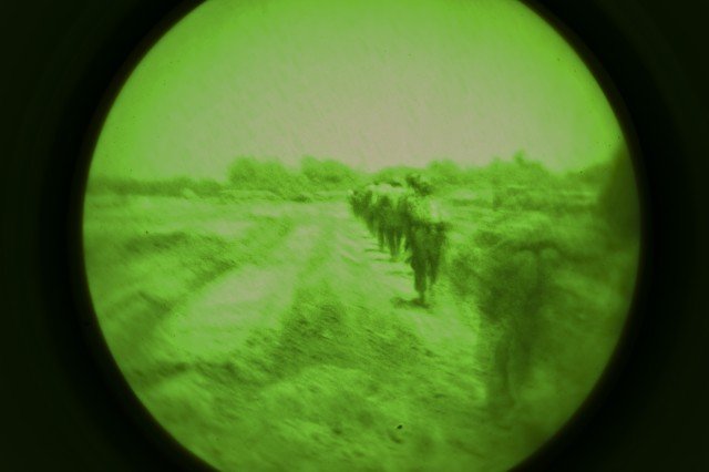 A group of Afghan Soldiers with 3rd Commando Kandak, and U.S. Special Forces Soldiers with Special Operations Task Force - South, walk alongside a plowed field during an operation to rid insurgent from Panjwa'i District, Oct. 25, 2010, in Kandahar Province, Afghanistan. (U.S. Army photo by Spc. Daniel P. Shook / Special Operations Task Force - South).