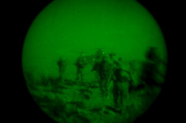 A group of Afghan Soldiers with 3rd Commando Kandak, and U.S. Soldiers with Special Operations Task Force – South, approach a CH-47 Chinook helicopter after completing an operation to impede Taliban activity, Oct. 26, 2010, in Panjwa'i District, Kandahar Province, Afghanistan. (U.S. Army photo by Spc. Daniel P. Shook/Special Operations Task Force – South).