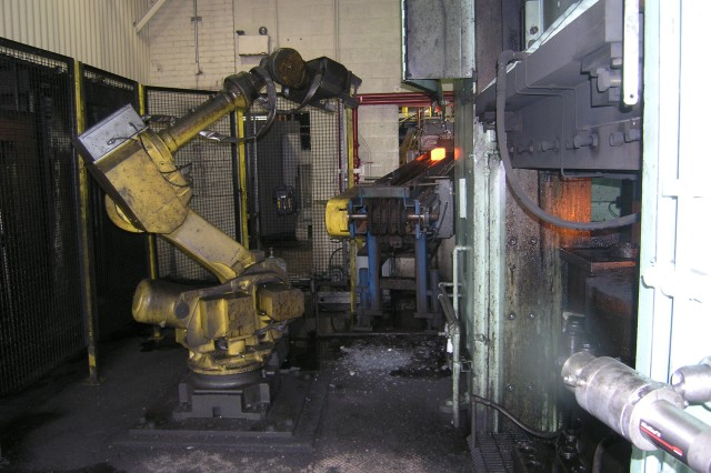 At SCAAP-A robot ready to pluck a hot piece of steel from a furnace.