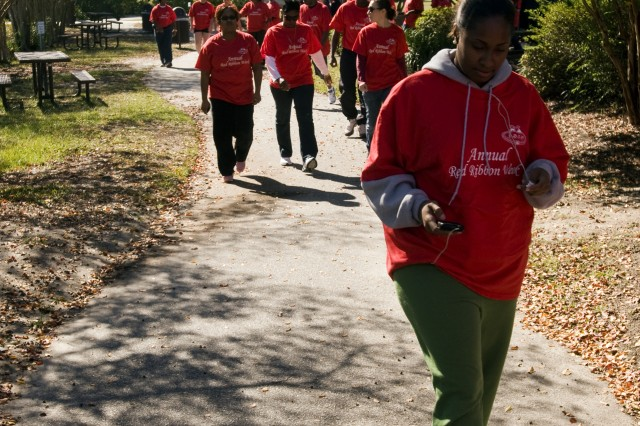 Several dozen Soldiers, civilians and family members participate in the 81st Regional Support Command's Red Ribbon Week 5-kilometer walk around Fort Jackson's Semme's Lake during their lunch break Oct. 29.