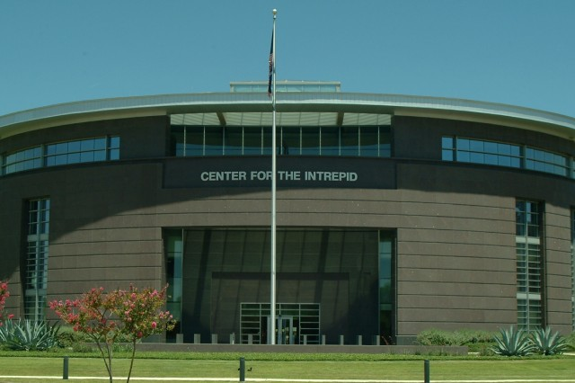 The Center for the Intrepid includes clinical, research, administrative space, a gait lab, a computer assisted rehabilitation environment, a swimming pool, an indoor running track, a two-story climbing wall and a prosthetic fabrication lab.