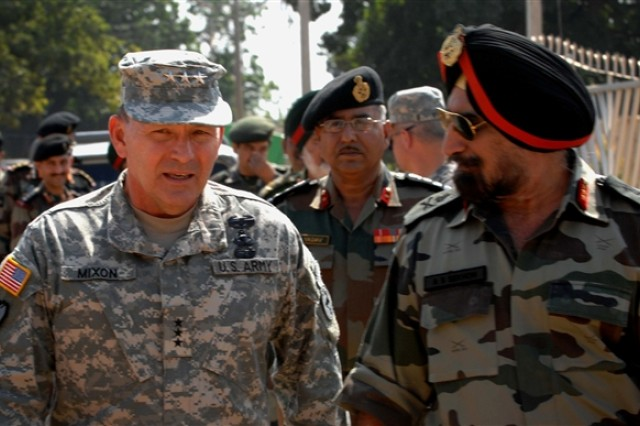Army Lt. Gen. Benjamin R. Mixon, commander of U.S. Army Pacific, talks with the director of general military operations for India before a demonstration put on by the two nations' militaries at Camp Bundela, India, during Yudh Abhyas 2009, Oct. 26,