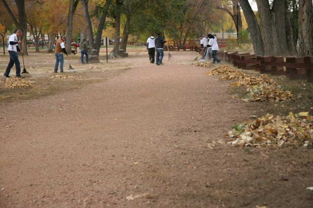 Soldiers rake leaves at Iron Horse Park Saturday in support of Make a Difference Day at Fort Carson, Colo., Oct. 23. Nearly 300 people showed up to rehab areas for the community.