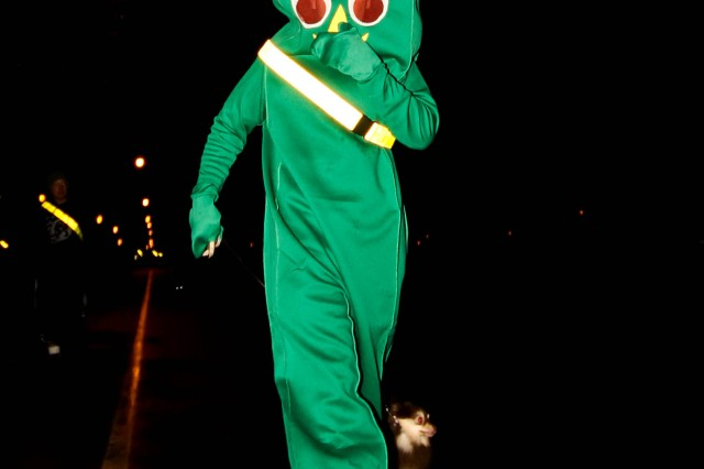 """""""Gumby"""" and his dog run for fun during the 593rd Special Troops Battalion Halloween """"costume run"""" Oct. 29. (U.S. Army photo/Capt. Michael Greenberger)"""