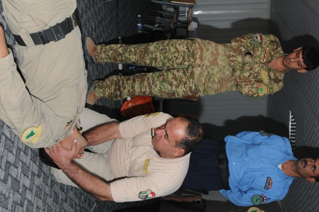 Hesham Ahmed, a Department of Border Enforcement worker, demonstrates how to open up the airway of an unconscious victim at the Shaiba Training Center Oct. 13. Ahmed is one of 12 students receiving training as a combat medic by the Iraqi Army instructors.