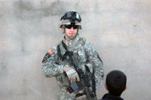 Former Sgt. Adam Poppenhouse poses for a photo during his deployment to Iraq in 2006.