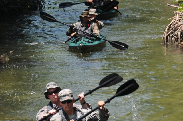 Combat Diver Qualification Course students execute a tactical kayak navigation exercise around Key West, Fla.