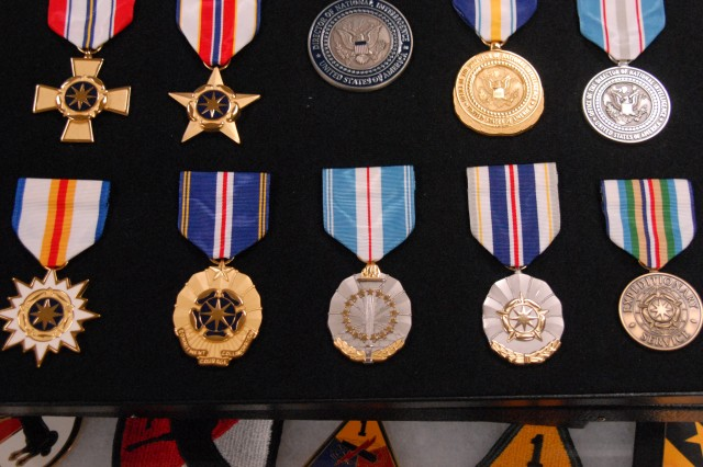 Medals and textile shoulder sleeve insignia designed by TIOH are on display at the institute.