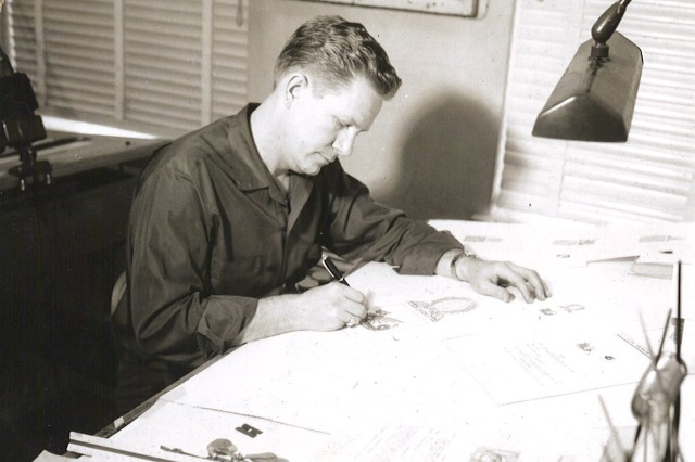 An illustrator works at TIOH in this historical photo.
