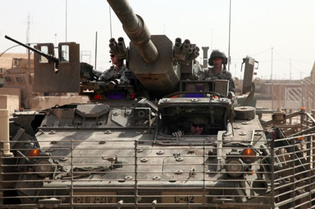 Soldiers of the 4th Stryker Brigade, 2nd Infantry Division, move to a location to launch the Raven, near Taji, Iraq. The Army Developmental Test Command's Aberdeen Test Center, a subordinate organization of the Army Test and Evaluation Command, played a key role in developing slat armor and helping the Army assess its effectiveness in the combat theater.