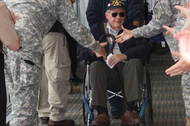 WWII Veterans arrive Tuesday at Dulles International Airport greeted by a deafening roar of applause and cheers as Soldiers, Sailors, Airmen, Marines, Coast Guardsmen and volunteers shake hands and thank each Veteran for their service.
