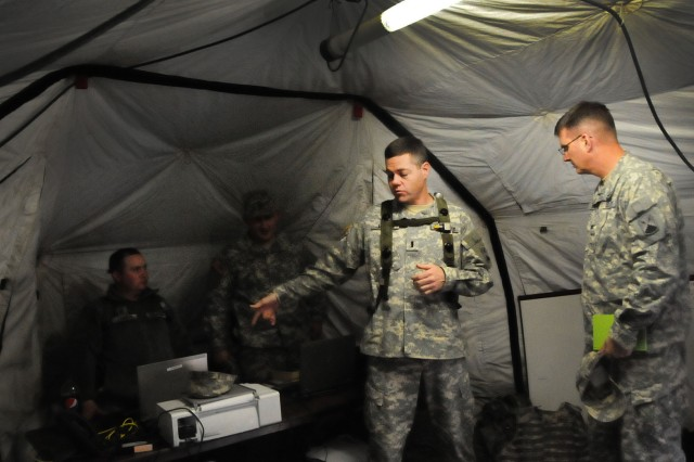 HOHENFELS, Germany -- 1st Lt. James E. Palidar, Alpha Co., 44th Expeditionary Signal Battalion, gives Col. John K. Arnold, commander, 7th Signal Brigade, details on the 44th ESB training at Camp Albertshof in preparation for the slated deployment.