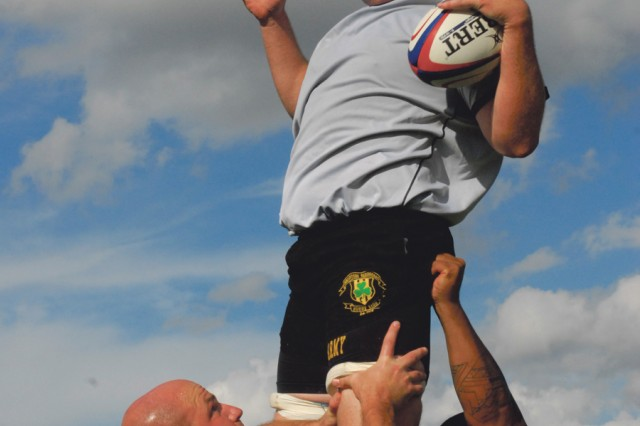 William Van Camp of Fort Stewart, Ga., is lifted high in the air by teammates Wednesday during a lineout drill at the All-Army rugby team's training camp on Stewart-Watson Field. The club is holding three-a-day workouts in preparation for its Wednesday opener against high-powered Air Force in the Armed Forces Rugby Championship.