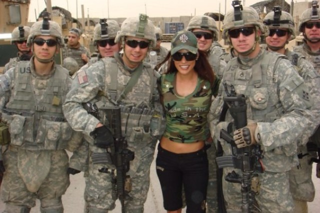 "Bonnie-Jill Laflin, an actress and model who founded Hounds and Heroes who ranked in the ""Maxim"" Hot 100 Women of 2005, visits with troops in Iraq."