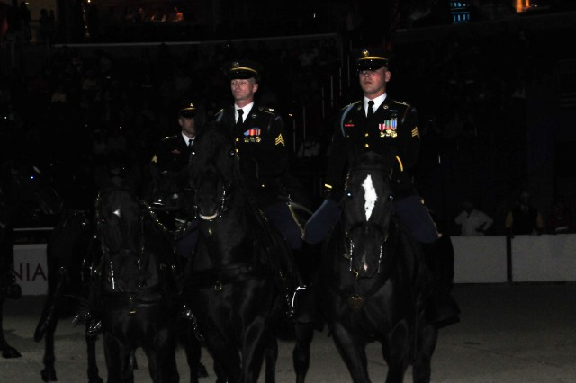More than 400 riders and 500 horses were downtown last weekend competing for about $400,000 in prize money, including Saturday night's $100,000 President's Cup Grand Prix. The Caisson Platoon was in attendance and demonstrated the different riding styles the soldiers use for training and for funerals. The demonstration ended with two Soldiers from the Equine Therapeutic Riding program taking center stage showcasing how Caisson horses rehabilitate Wounded Warriors.