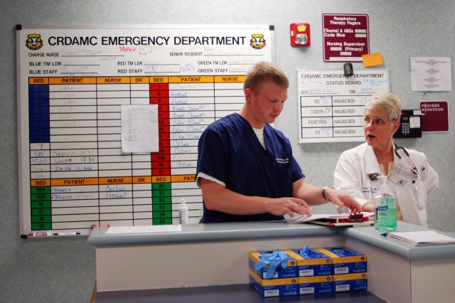 Dr. Emily Jean Lucid, attending physician in the CRDAMC Emergency Room, mentors Dr. (Capt.) Jonathan Wiese, resident intern, during his shift in the ER.