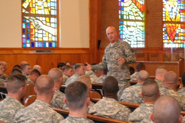 Command Sgt. Maj. Neil Ciotola, IMCOM command sergeant major, speaks to the 1st Battalion, 63rd Armor Regiment, 2nd Heavy Brigade Combat Team, 1st Infantry Division noncommissioned officers during their NCO Professional Development class Oct. 21 at Kapaun Chapel, Fort Riley, Kan.