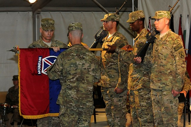 10th Mountain Division (LI) commander Maj. Gen. James L. Terry and 10th Mountain Division (LI) Command Sgt. Maj. Christopher Greca unfurl the division colors during a transfer of authority ceremony on Kandahar Airfield Tuesday. Terry and Greca are taking over as the command team for Regional Command South.