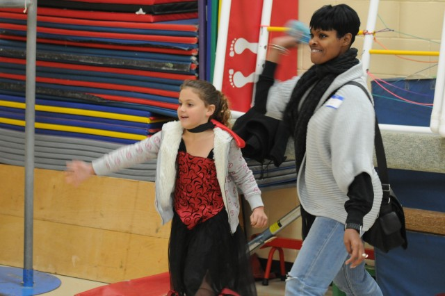 Cpt. Dina Smith, an integration officer with the 3d ESC's support operation section and Norfolk, Va. native, plays a game with a Pierce Elementary youngster during the school's Fall Festival, Oct. 29.  The 3d ESC sponsors Pierce Elementary and has assisted in many events for the school. (U.S. Army photo by Sgt. Michael Behlin)
