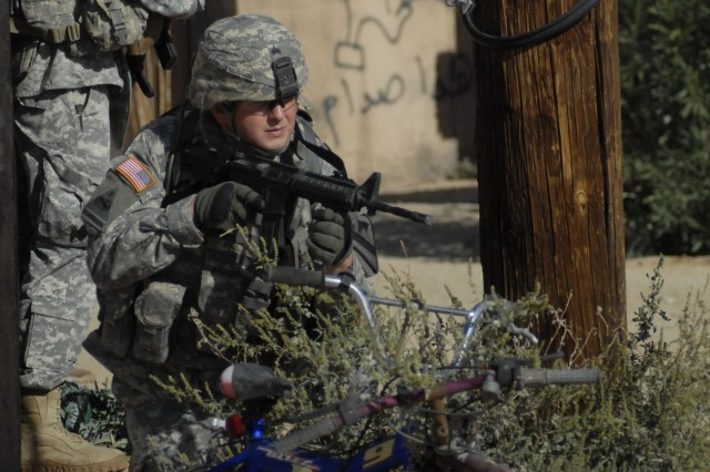 Sgt. Luke Kilhullen, 6th Squadron, 9th Cavalry Regiment, 3rd Brigade Combat Team, 1st Cavalry Division, provides security for squad members during training at Fort Irwin, Calif.