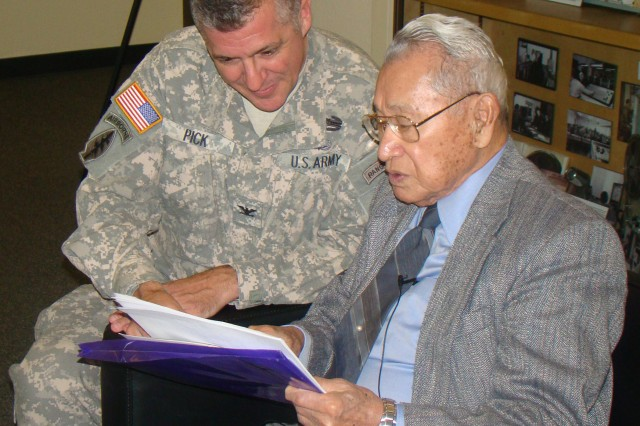 PRESIDIO OF MONTEREY, Calif. - DLIFLC Commandant Col. Danial Pick appears interested in plans for the Japanese American Museum shown by retired Col. Thomas Sakamoto.