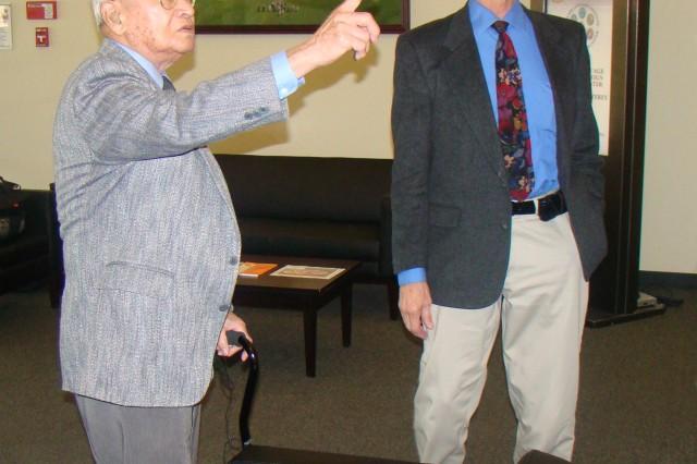 PRESIDIO OF MONTEREY, Calif. - Retired Col. Thomas Sakamoto has a query for DLIFLC Command Historian Dr. Stephen Payne regarding a lobby display in the DLIFLC Headquarters Building.