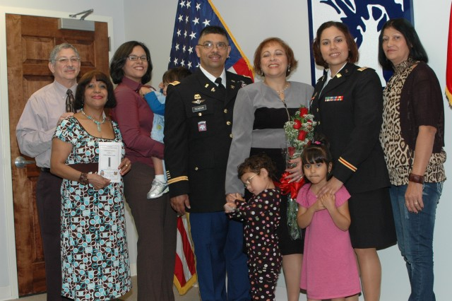 FORT BRAGG, N.C. (Nov. 3, 2010) -- Army Forces Command's Food Service advisor, Chief Warrant Officer Five Princido Texidor, is surrounded by members of his supportive Family who attended his promotion ceremony. They are (left to right) his brother, Master Sgt. (Retired) Eladio Alicea-Cruz; sister-in-law, Laura Alicea-Cruz; daughter. Jacqueline Quinones; grandson Angel Martinez; CW5 Texidor; his wife, Ixia; granddaughter, Ixiamarie Martinez; granddaughter Yabeliz Texidor; daughter, Capt. Catherine Martinez; and Capt. Martinez's mother-in-law, Margarita Dejesus.