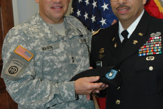 FORT BRAGG, N.C. (Nov. 3, 2010) -- Maj. Gen. Raymond V. Mason (left), Army Forces Command's G4/Director of Logistics, presents Chief Warrant Officer Five Princido Texidor with his beret bearing his new rank. He is the first Hispanic Army warrant officer to achieve the rank of CW5 in the Army's Food Service branch. CW5 is the highest rank that can be obtained in the Warrant Officer Corps. Texidor is the Army Forces Command Food Service advisor.