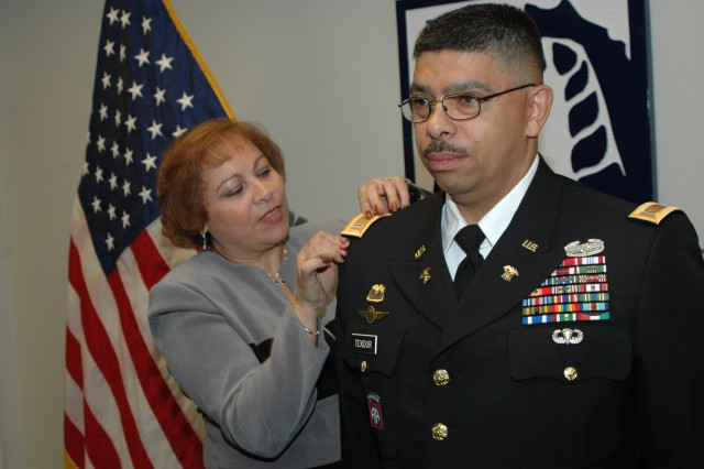 FORT BRAGG, N.C. (Nov. 3, 2010) -- Chief Warrant Officer Five Princido Texidor's wife, Ixia (left), pins on his new rank. He is the first Hispanic Army warrant officer to achieve the rank of CW5 in the Army's Food Service branch. CW5 is the highest rank that can be obtained in the Warrant Officer Corps. Texidor is the Army Forces Command Food Service advisor.
