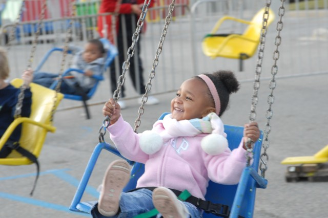 A girl enjoys the swing ride at last year's Military Family Month fun fair. Throughout November, numerous events are planned to honor military families, culminating with a ceremony Nov. 22. For a list of this year's events, see Page 22.
