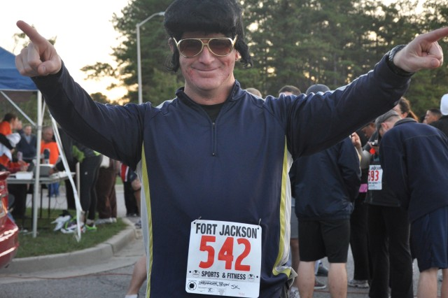 """Thanks to Bryan Hernandez, commander of the 3rd Battalion, 34th Infantry Regiment, the """"King"""" - Elvis Presley - made an appearance at Saturday's run. Along with Elvis, costumes included a baby spider, a WNBAplayer, a ballerina and a couple of cats."""