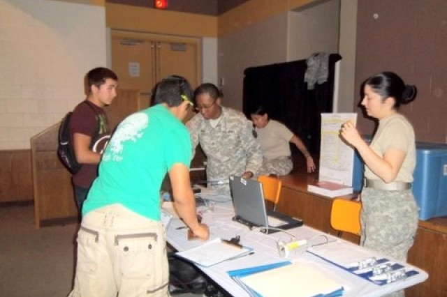 Volunteers and troops take a break at the McGregor ROTC blood drive