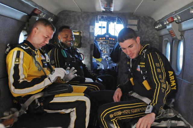 Inside the Golden Knight's UV18 Twin Otter aircraft, jumpers buckled their seatbelts and prepared for takeoff.