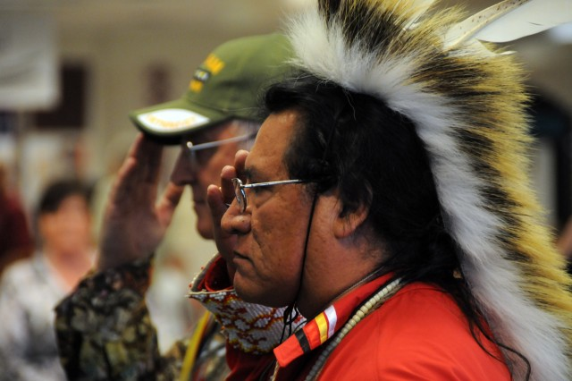 Richard Greybull (Foreground) and Donald Miller post the colors at the Native American Heritage Celebration at the post exchange, Oct. 29.