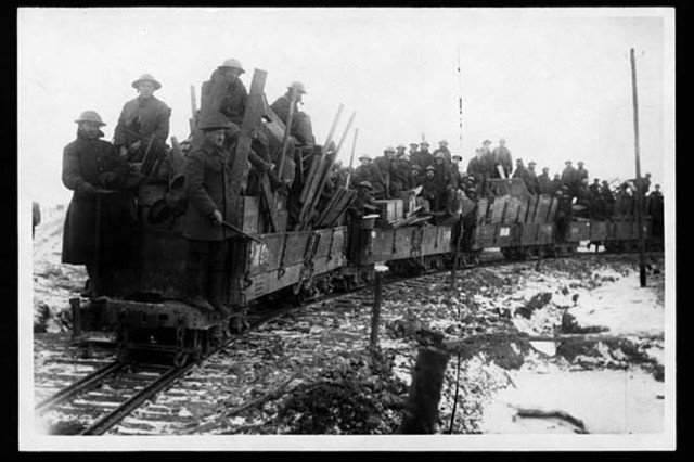 Soldiers and supplies head to the front.