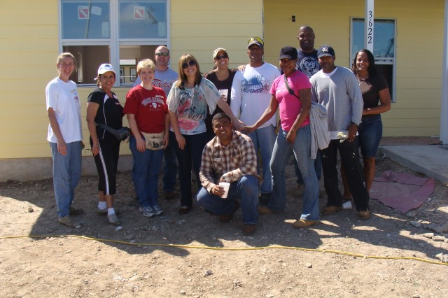 Gathered to help Habitat for Humanity are: Lt. Col. Lynda Royse, Marisol Chanis, Maj. Mary Leavitt, Maj. Carl Oelschig, Betzy Quintero, Master Sgt. (P) Eliecer Quintero (front), Elisabeth Sanders, Col. William Sanders, Sgt. 1st Class April Johnson, Lt. Col. Vernon Meyers, Sgt. Maj. Vincent Fontenot, and Tammie Fontenot.