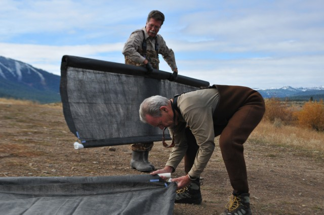 MARTIS CREEK LAKE, Calif. (Nov. 5, 2010) - Volunteers assemble sunlight barriers here Oct. 31 as part of a project to eradicate invasive Eurasian milfoil plants from the lake bottom. The gas-permeable barriers kill the milfoil plants by blocking sunlight, but don't disturb other plant and animal species native to the lake. The Corps is partnering with the Tahoe Divers Conservancy on the project, funded by a $20,000 grant from the Community Foundation of Western Nevada's Truckee River Fund.