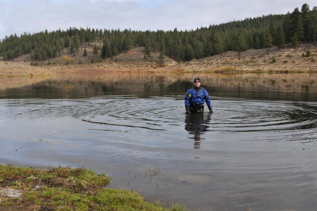 MARTIS CREEK LAKE, Calif. (Nov. 5, 2010) - Phil Caterino of the Tahoe Divers Conservancy wades in to place sunlight barriers here Oct. 31 as part of a project to eradicate invasive Eurasian milfoil plants from the lake bottom. The gas-permeable barriers kill the milfoil plants by blocking sunlight, but don't disturb other plant and animal species native to the lake. The Corps is partnering with the Tahoe Divers Conservancy on the project, funded by a $20,000 grant from the Community Foundation of Western Nevada's Truckee River Fund.