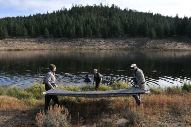 MARTIS CREEK LAKE, Calif. (Nov. 5, 2010) - Volunteers place sunlight barriers here Oct. 31 as part of a project to eradicate invasive Eurasian milfoil plants from the lake bottom. The gas-permeable barriers kill the milfoil plants by blocking sunlight, but don't disturb other plant and animal species native to the lake. The Corps is partnering with the Tahoe Divers Conservancy on the project, funded by a $20,000 grant from the Community Foundation of Western Nevada's Truckee River Fund.
