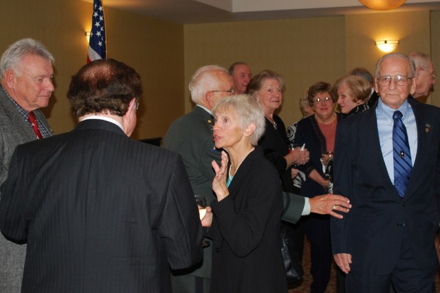 CORAOPOLIS, Pa. - Former 99th Infantry Division Soldier, including World War II veteran, Harry McCraken (far right), and their families gather at the Doubletree hotel here Oct. 23 for a reunion dinner hosted by the Associates of the 99th Inf. Div., Inc. The organization has been hosting regular reunions since 1993. McCraken, the current chairman, was one of the original founders and first vice-president.