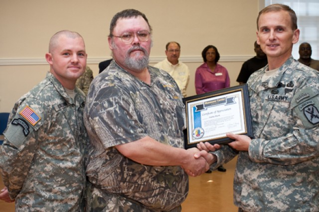 Staff Sgt. Chance Vaughn joined Command Sgt. Maj. Chris Hardy, senior enlisted for the Maneuver Center and Fort Benning, in presenting the inspired leadership award to Freddy Wynn last month in recognition of his selfless service.